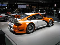 911 GT3R Hybrid. Race version of the well known Porsche 911 (of which there's a street legal version in the background). This particular version with hybrid Royalty Free Stock Images