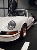 911 RS 2.7. A white Porsche 911 Carrera RS 2.7 at the Tag Heuer stand in the Milano Autoclassica exhibition. In the stand it was reproduced a racetrack starting Royalty Free Stock Photography
