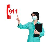 911 symbol. Happy doctor pointing to 911 symbol Royalty Free Stock Photography