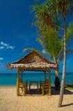 9227-1on the beach. Bamboo house on the sandy beach Royalty Free Stock Photos