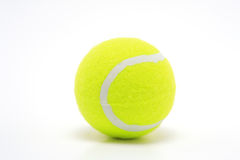 998383RF. A single yellow tennis ball on white surface Royalty Free Stock Image