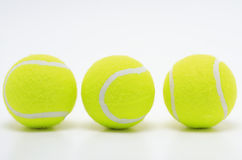 998384RF. Three yellow tennis balls on white surface Royalty Free Stock Photos