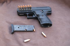 9mm. Hand gun with clip out and extra ammo ready stock photos