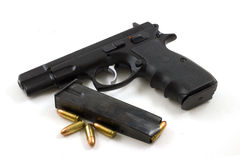 9mm With Clip and Four Bullets. A 9mm semi-automatic pistol with four bullets and an extra clip Stock Photo