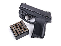 9mm Handgun & Ammo. 9mm Handgun and a box of Ammo Royalty Free Stock Photo