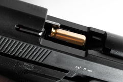 9mm handgun with bullet Royalty Free Stock Image