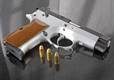 9mm handgun with bullets. 9mm automatic handgun with bullets Royalty Free Stock Photo
