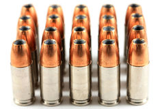 9mm Handgun Hollow-point Ammunition. Twenty rounds of 9mm hollow-point handgun ammunition sits in an orderly rank and file Royalty Free Stock Image