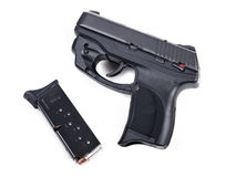 9mm Handgun & Magazine. 9mm Handgun isolated with a filled magazine Royalty Free Stock Photography