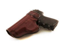 9mm in Leather Holster. A 9mm backup handgun in leather holster isolated against a white background Stock Photo