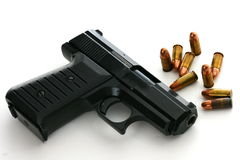 9mm Pistol with Ammo. 9mm handgun, pistol with ammo and white space Royalty Free Stock Photos