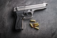Free 9mm Pistol Bullets And Handgun. Stock Image - 102980961
