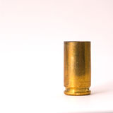 9mm shell casing. One Dirty 9 mm shell casing primer down Royalty Free Stock Photo