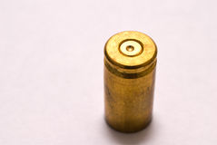 9mm shell casing. One Dirty 9 mm shell casing primer up Stock Photo