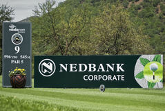 9th Tee. 596 yards, 545 meters, Par 5, flanked by the advertising hoardings of the event sponsors Stock Photos