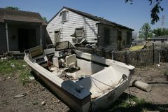 9th Ward home with boat in front yard. A heavily damaged home in the Ninth Ward of New Orleans. A boat without a motor sits in the front yard Royalty Free Stock Photography