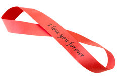 """'I love you forever"""" sigh on red tape. In shape of infinity, on white stock images"""