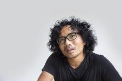 Ação asiática da cara do homem no branco Imagens de Stock