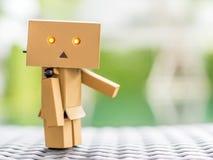 Ação bem-vinda da boneca da caixa Foto de Stock