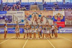 Ação Cheerleading do campeonato Imagem de Stock Royalty Free
