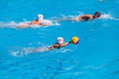 Ação da piscina do polo aquático Fotografia de Stock Royalty Free