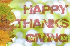 Ação de graças feliz escrita no fundo do bokeh Imagem de Stock
