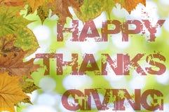Ação de graças feliz escrita no fundo do bokeh Imagens de Stock