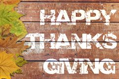 Ação de graças feliz escrita no fundo de madeira Imagem de Stock Royalty Free