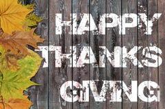 Ação de graças feliz escrita no fundo de madeira Fotografia de Stock
