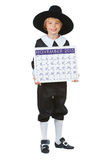 Ação de graças: Menino do peregrino com o calendário 2015 Fotografia de Stock Royalty Free