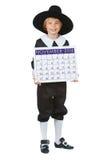 Ação de graças: Menino do peregrino com o calendário 2014 Fotografia de Stock Royalty Free