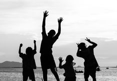 Ação de salto da silhueta da criança Fotos de Stock Royalty Free