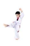 Ação de Taekwondo por um menino bonito asiático Imagem de Stock