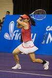 A ação disparou em Zheng Jie na prova final dos campeões Foto de Stock