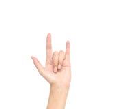 Ação do close up da mão da mulher eu te amo no significado no fundo branco Foto de Stock Royalty Free