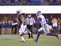2014 ação do futebol do NCAA - estado de WVU-Kansas Fotos de Stock