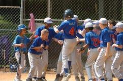 Ação do jogo de basebol da liga júnior Imagem de Stock Royalty Free