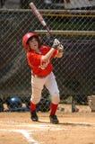 Ação do jogo de basebol da liga júnior Fotos de Stock