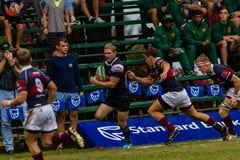 Rugby Running Outeniqua da bola do jogador Foto de Stock