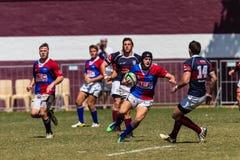Rugby Framesby da ação da bola dos jogadores Imagem de Stock Royalty Free
