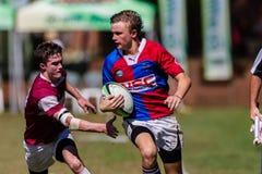 Rugby Framesby da bola da asa do jogador Imagem de Stock