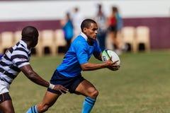 Habilidade Running da bola do rugby do jogador Fotografia de Stock Royalty Free