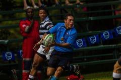 Asa da bola da passagem do rugby do jogador Fotografia de Stock Royalty Free