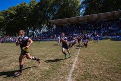 Funcionamento-Para fora invicto de Outeniqua do rugby Fotografia de Stock