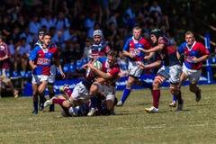 Rugby Framesby da ação da bola dos jogadores Fotografia de Stock Royalty Free