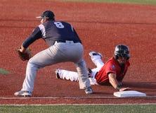 Ação no jogo de basebol Fotos de Stock