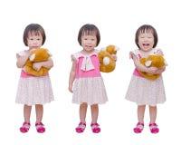 Ação três da menina com brinquedo do urso Fotografia de Stock