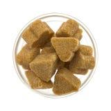 Açúcar de Brown em uma bacia de vidro Fotografia de Stock Royalty Free