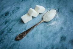 Açúcar e colher Imagens de Stock Royalty Free