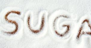 Açúcar escrito no pó do açúcar video estoque